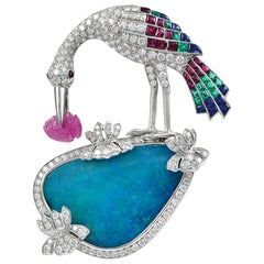 Uniquely Designed Platinum Bird Brooch with Diamonds and Gemstones
