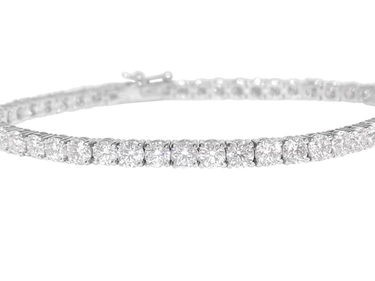 Metal: 14k white gold.  9.10 carat diamonds total. Round brilliant cut. VVS clarity.  100% natural earth mined diamonds 20 pointer diamonds. Setting: prongs Style: Tennis bracelet. Tongue hook.  10.73 grams. 7 inches.   Brand new custom made tennis