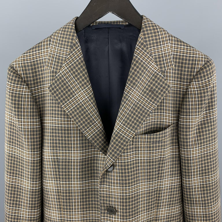 UNITED ARROWS / SOVEREING Sport Coat comes in a brown plaid wool material, with a notch lapel, slit pockets, three buttons at closure, single breasted, functional buttons at cuffs, and a double vent at back.   Excellent Pre-Owned Condition. Marked: