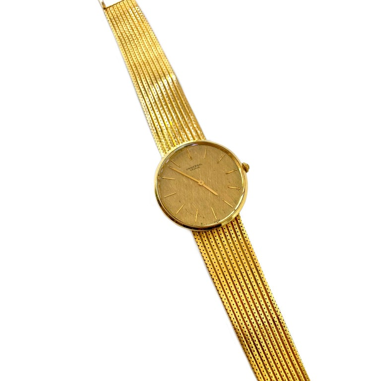 Universal Geneve 18 Karat Yellow Gold Wrist Watch circa 1960's. The watch contains the original 21 jewel mechanical wind movement. The design of the round dial is a unique cross hatch pattern enclosed within a 33mm case. The length of the band is 7