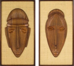 Mid-Century Carved Wood Relief Mask Wall Sculpture Panel, a pair