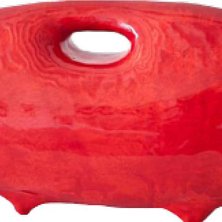 Suitcase-Red by artist James Marshall is a red contemporary design piece made of ceramic that measures 6 x 18 and is priced at $3,200.    Vitae  1949 Born near Pittsburgh, PA  Resides and maintains a home and 2 studios in Santa Fe, New
