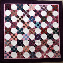 """Four-Petal Flowers in Octagons with  Nine Patch Squares"" quilt"