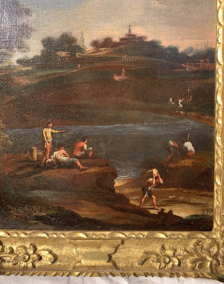 Venetian master of the 18th century. - River landscape with characters.   34 x 26 cm without frame, 43 x 35 cm with frame.  Oil on canvas, in a carved and gilded wooden frame.