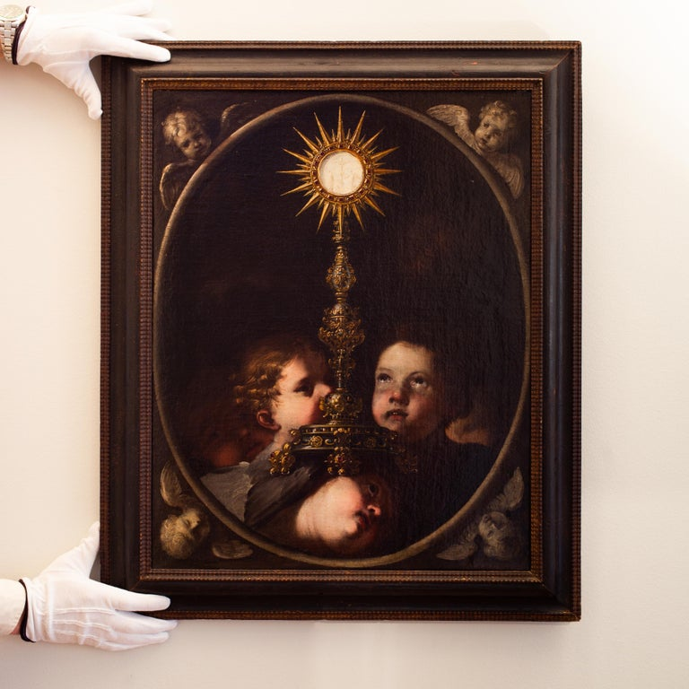 A Holy Monstrance Surrounded by Putti, Genoese School, c.1620-30, Oil on Canvas - Black Portrait Painting by Unknown