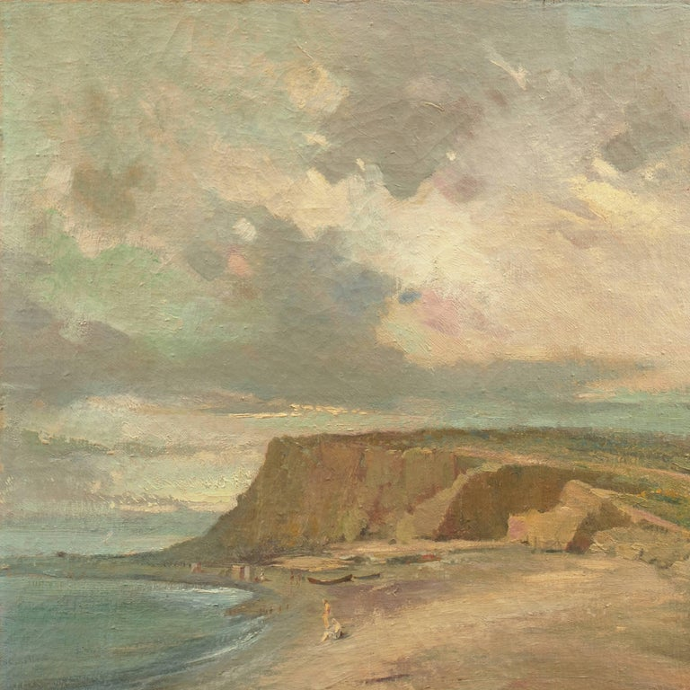 Signed lower right, 'F. Ferraro', titled indistinctly and painted circa 1925.  A panoramic Mediterranean coastal landscape showing a view of figures on a sandy beach with a cottage tucked into the lee of a hill. An elegant and painterly treatment
