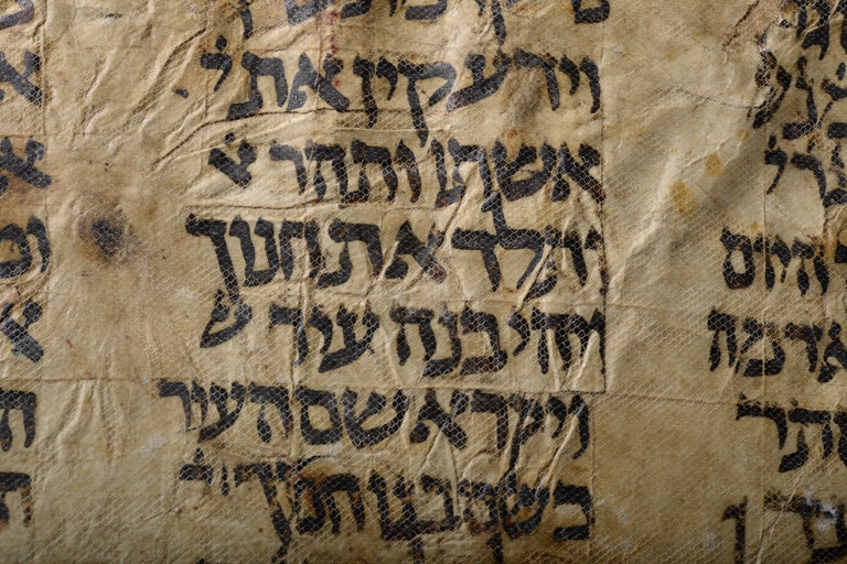 A fragment of one of the earliest surviving Hebrew Bible manuscripts, dating to the 9th or 10th century. From the Cairo Genizah, the famous cache of manuscripts from the Ben Ezra Synagogue, Cairo, Egypt.  Written in black ink on vellum, in large,