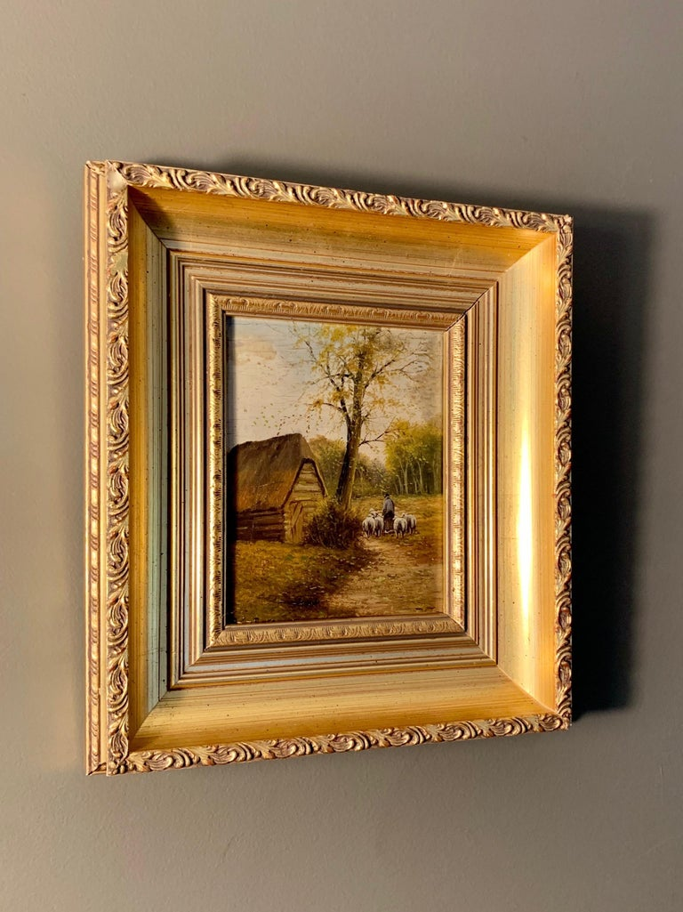 Petite French Barbizon school painting showing a shepherd guiding his herd in a wooded landscape. This peaceful little painting is housed in a matching gild frame from the period.