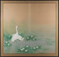 Egrets Among Lotuses
