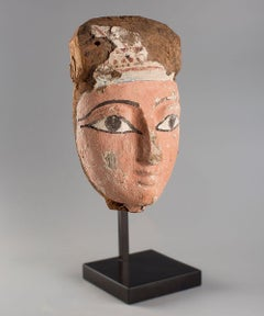 Egyptian mask in sycamore wood and stuccoed in pink. 6th century BC