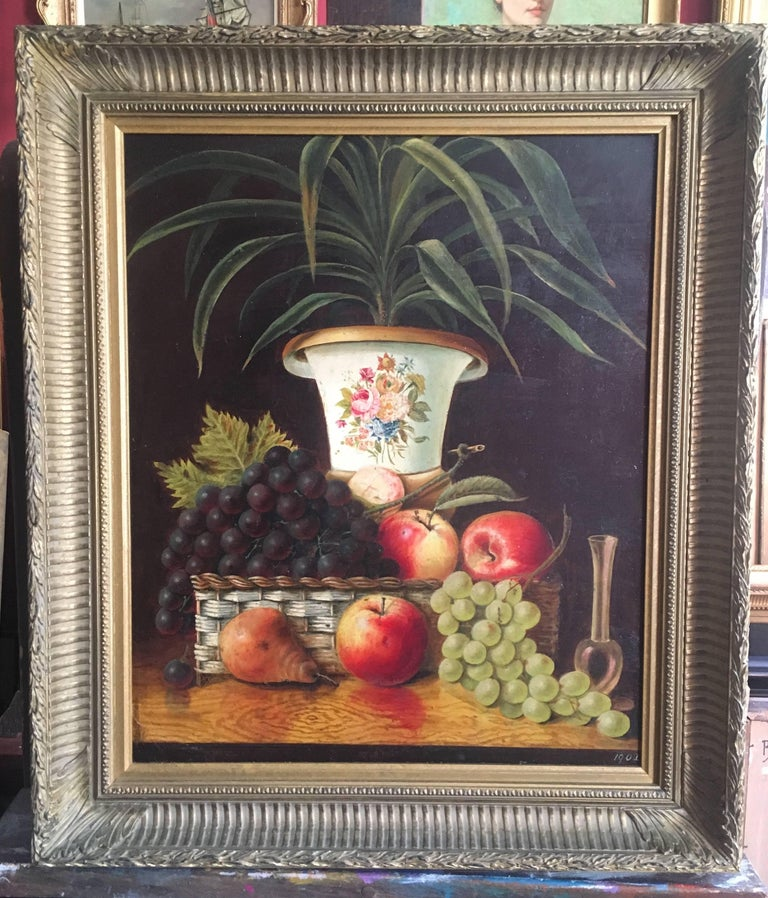 Fine Still Life Fruit  English School, Early 20th Century  Oil painting on board, framed Dated '1902' on the lower right corner Framed size: 25 x 22 inches  Lovely details especially to the vase, to which there is a beautiful flower motif on the