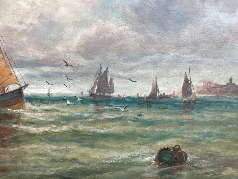 An antique painting in elaborate gold-leafed frame of fishing boats on a choppy day, with a lighthouse visible on a point of land in the distance. Superb details and wonderful treatment of chops and swells, and subtle shifts in color as the light