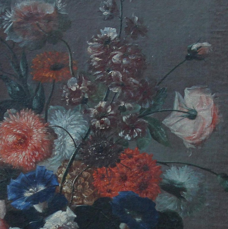 A fine Dutch Old Master floral still life. Painted circa 1700, this oil on canvas depicts peonies roses, convolvulus and other flowers in a bronze vase. A superb 17/18th century Old Master in a fine 18th century carved gilt rococo frame. It is