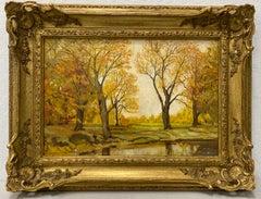 Forested Landscape in Golden Light Housed in a Gilded Frame