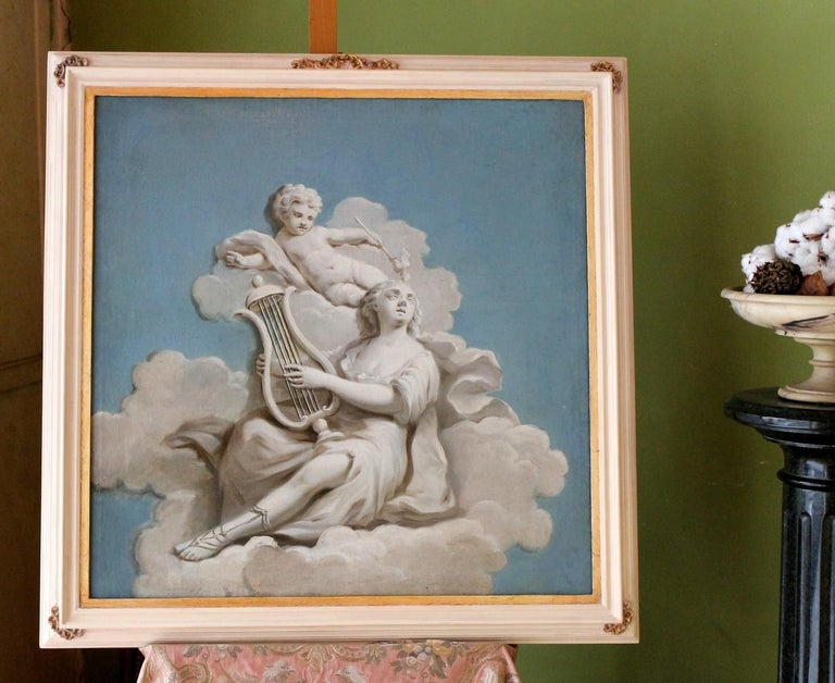 This romantic French 19th century allegoric oil painting on square canvas has a sky blue background, a fluffy cloud fills the central part of the painting where a woman is lying down playing the lyre, while a graceful cherub seems to twirl over