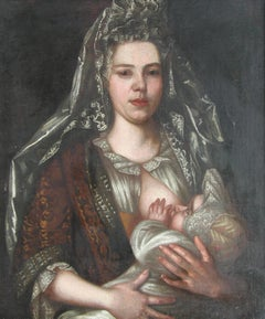 Lady Nursing a Baby