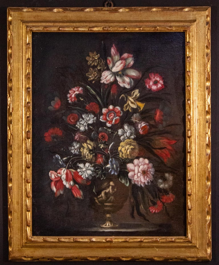 Pair of very decorative Italian Still-life paintings of flowers with vases and classical figures . 18th century, oil on canvas,  with original gilt-wood frames.  This pair is an excellent example of the Italian  trend of emulating the Flemish still