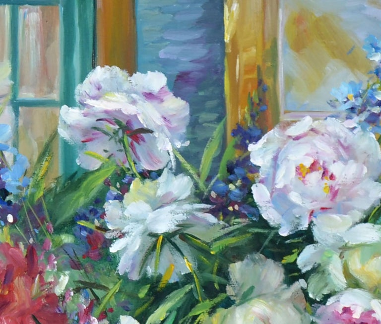 Fresh, full blossoms of Peonies in two colors plus a little Larkspur come together in this vibrant floral still life in rich, varied colors by an unknown artist (American, 20th Century). Unsigned. Displayed in a rustic, painted white wood frame.