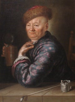 Portrait of a Gentleman wearing a Smoking Jacket, and Fur Hat, seated beside a L