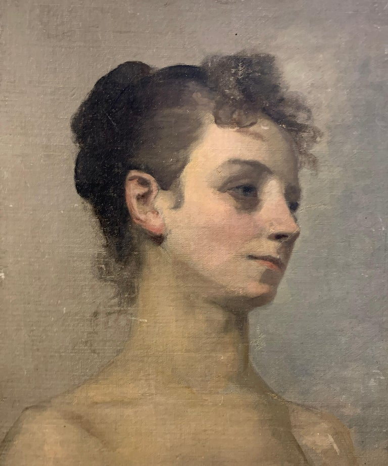 Painted on a neutral background allowing the subject to stand out beautifully, this mid century figurative oil on board painting features the portrait of a woman, posing in a slightly angled frontal view with bare shoulders and her hair fair tied