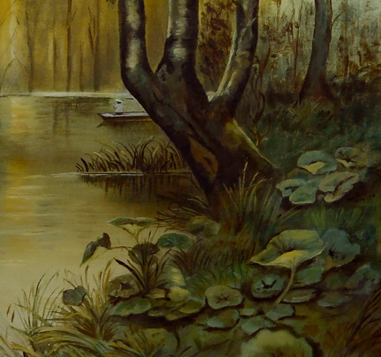 Serene mid century landscape of a golden sun rising over a wooded forest stream with a small figure in a canoe by an unknown artist. Unsigned. Displayed in a giltwood frame. Image size: 27