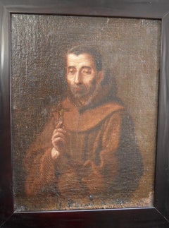 Spanish School 17th Century, Saint Francis holding a cross, oil on canvas