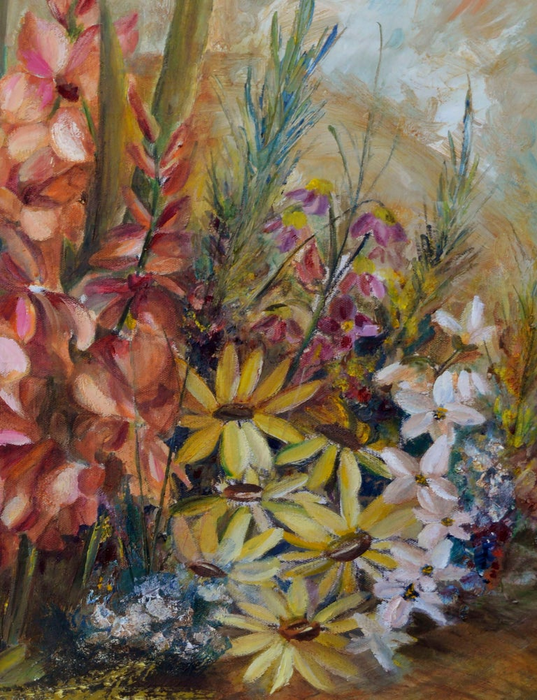 Vivid floral still-life of colorful flowers bursting from a blooming spring garden by an unknown artist (American, 20th Century). Unsigned. Displayed in a rustic wood frame. Image size: 30