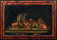 Still Life Of Pears, Apples and Grapes in an upturned basket, 17th Century
