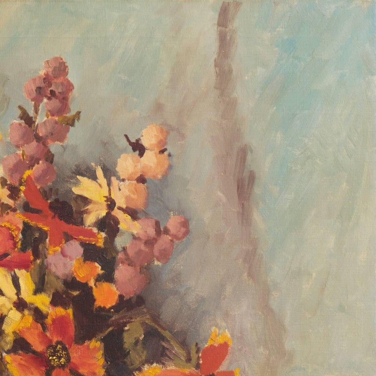 Signed lower right, 'S. L. Kramer' (American, 20th century) and painted circa 1960.  A mid-century, oil still-life showing a bouquet of spring flowers informally arranged in a glass vase, set upon a coral tablecloth and contrasted against a