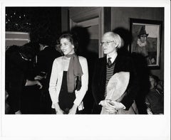 Andy Warhol with a laughing Woman