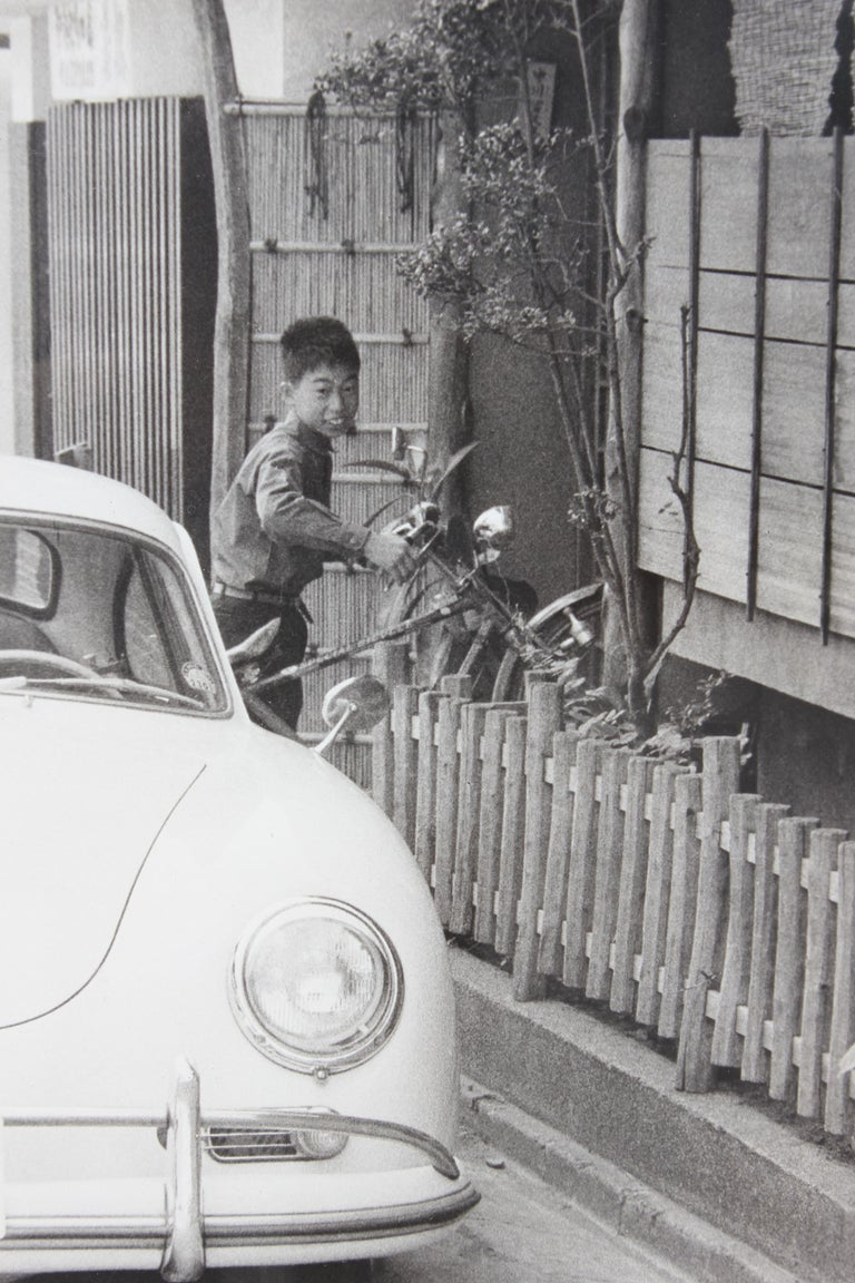 Black and White Japanese Photograph of a Porsche and Boy - Gray Portrait Photograph by Unknown