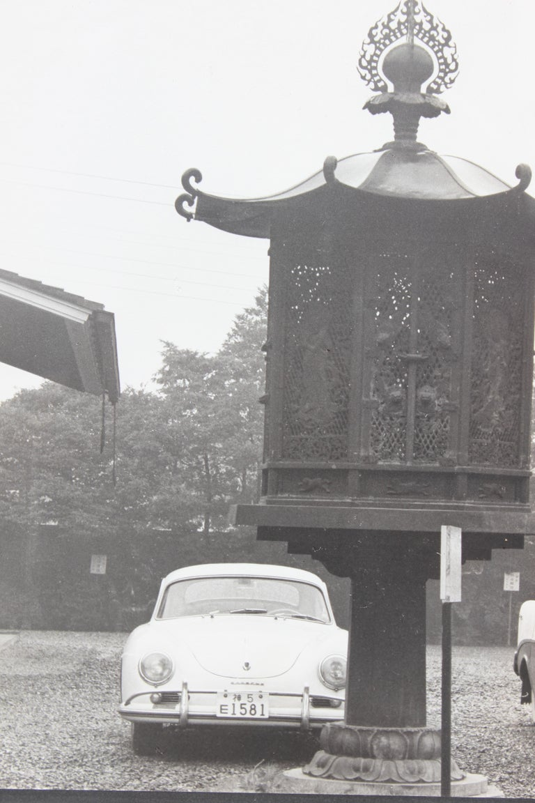 Stunning 1960's black and white photograph still-life of a Porsche behind a large traditional Japanese lantern with trees in the background.