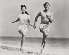 Burt Lancaster and Ava Gardner Running on the Beach Globe Photos Fine Art Print