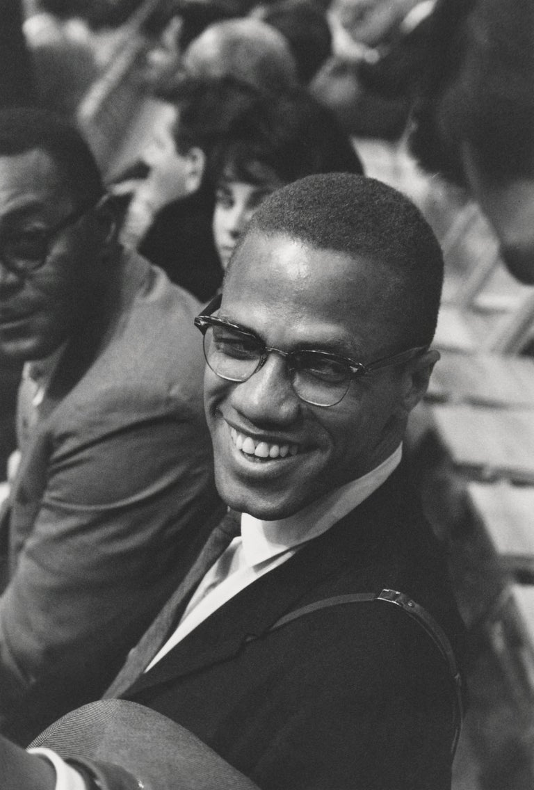 Unknown Black and White Photograph - Candid Malcolm X Smiling at an Ali Fight Fine Art Print