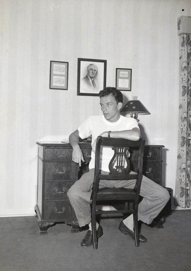 Unknown Black and White Photograph - Frank Sinatra - Sitting at Desk