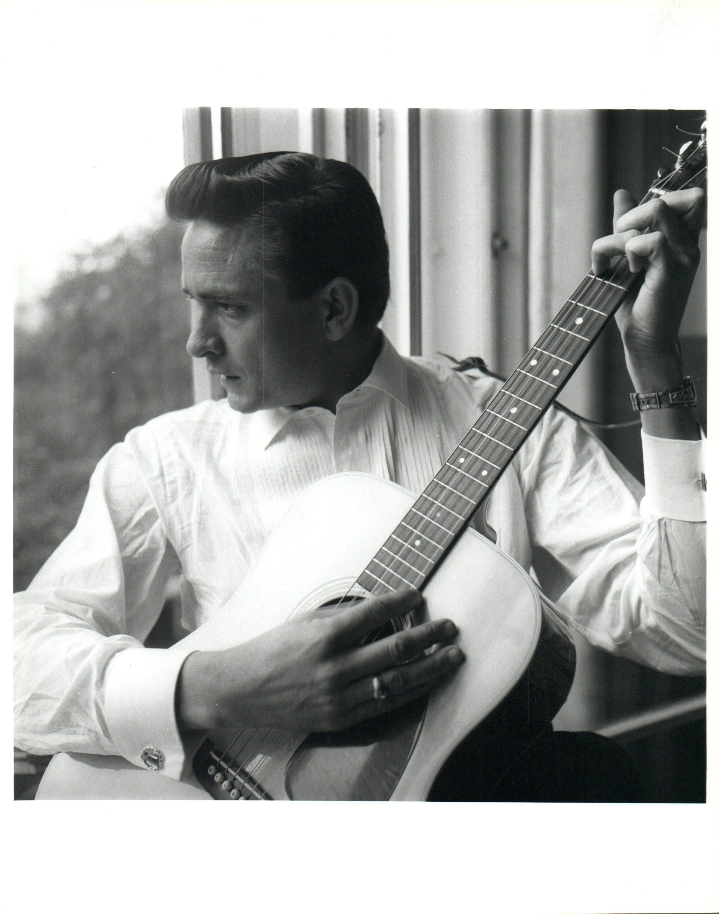 Unknown johnny cash playing guitar in windowlight vintage original photograph