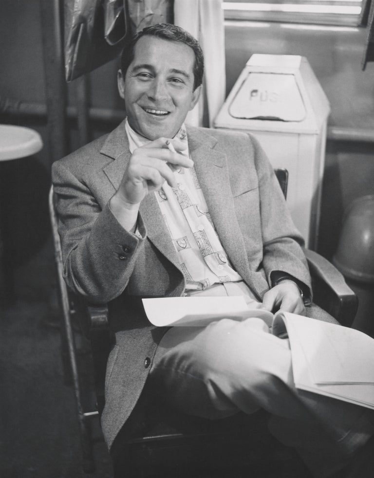 Unknown Black and White Photograph - Perry Como Smiling and Smoking Fine Art Print