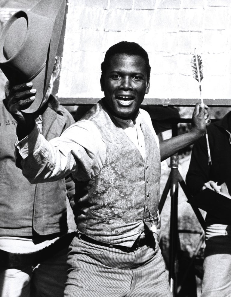 Unknown Black and White Photograph - Sidney Poitier with Cowboy Hat and Arrow Fine Art Print