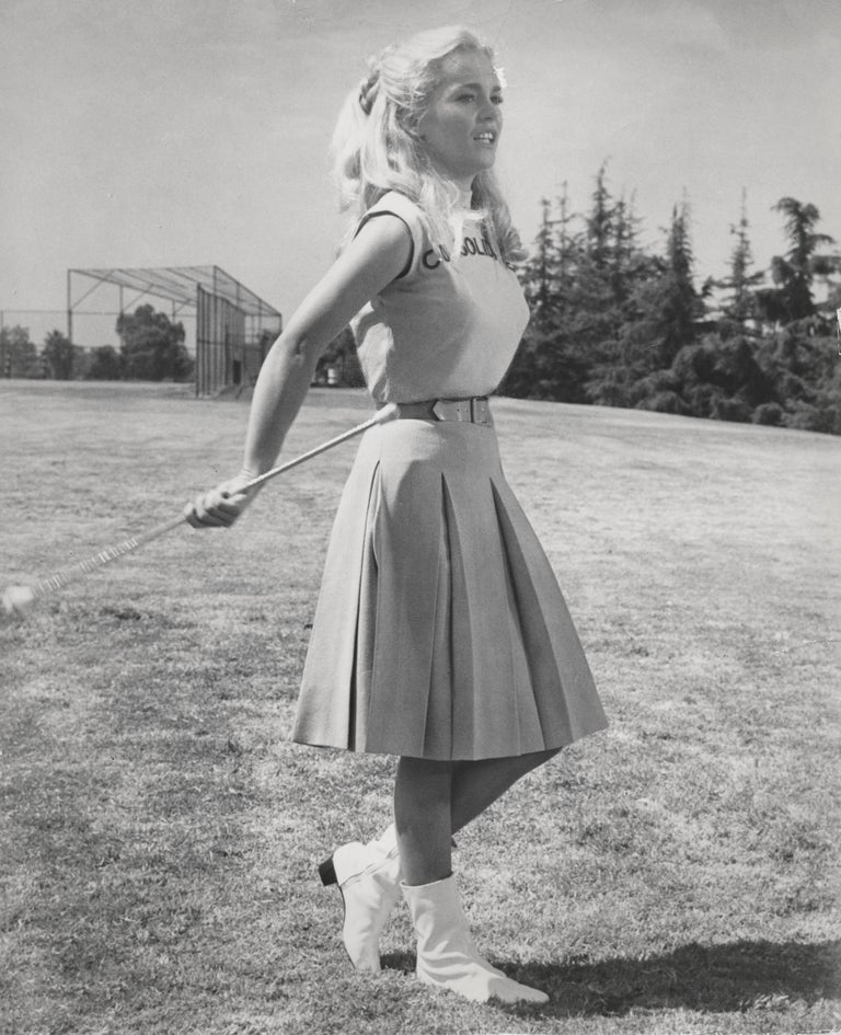Unknown Black and White Photograph - Tuesday Weld Twirling Baton Fine Art Print