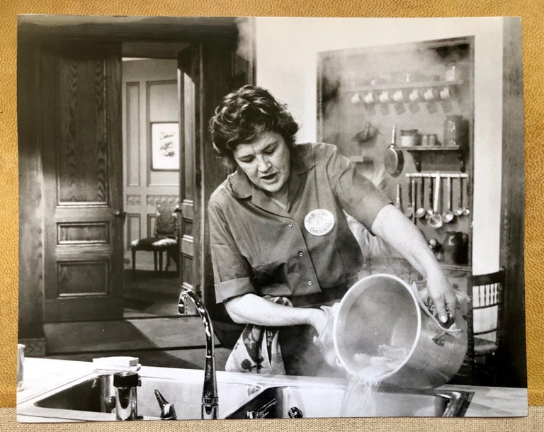 Jjulia Child draining lasagna noodles. Julia makes lasagna a la Francaise on the french chef. This is a vintage photo from a newspaper archive. Julia Childs makes cooking cooking fun and easy... side profile photo black & white  portrait. Julia