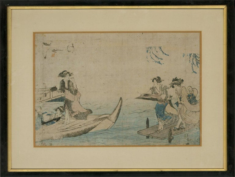 A fine example of late 18thC Japanese Ukiyo-e woodblock printing. The print shows geisha relaxing on a river boat with awning, close to a jetty, along which two more geisha run, carrying a tray full of food and eating utensils. The artist has