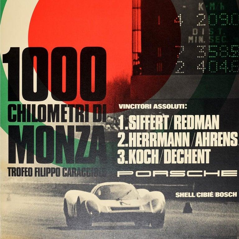 Original vintage motorsport poster celebrating Porsche victory at the 1000 Kilometres of Monza / 1000 Chilometri di Monza Trofeo Filippo Caracciolo featuring a dynamic auto racing design depicting a black and white photograph of a Porsche car racing