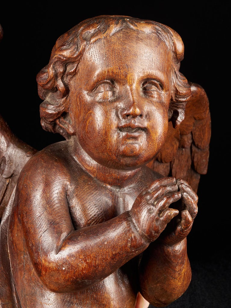 This elegant, beautifully polished angel holds his hands together as if in prayer. The sculpture may have been part of a wooden pulpit. The fact that the statue has been carefully worked out on all sides confirms this hypothesis. The face,