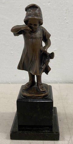 19th Century Miniature Bronze Sculpture of a Young Girl Holding a Doll