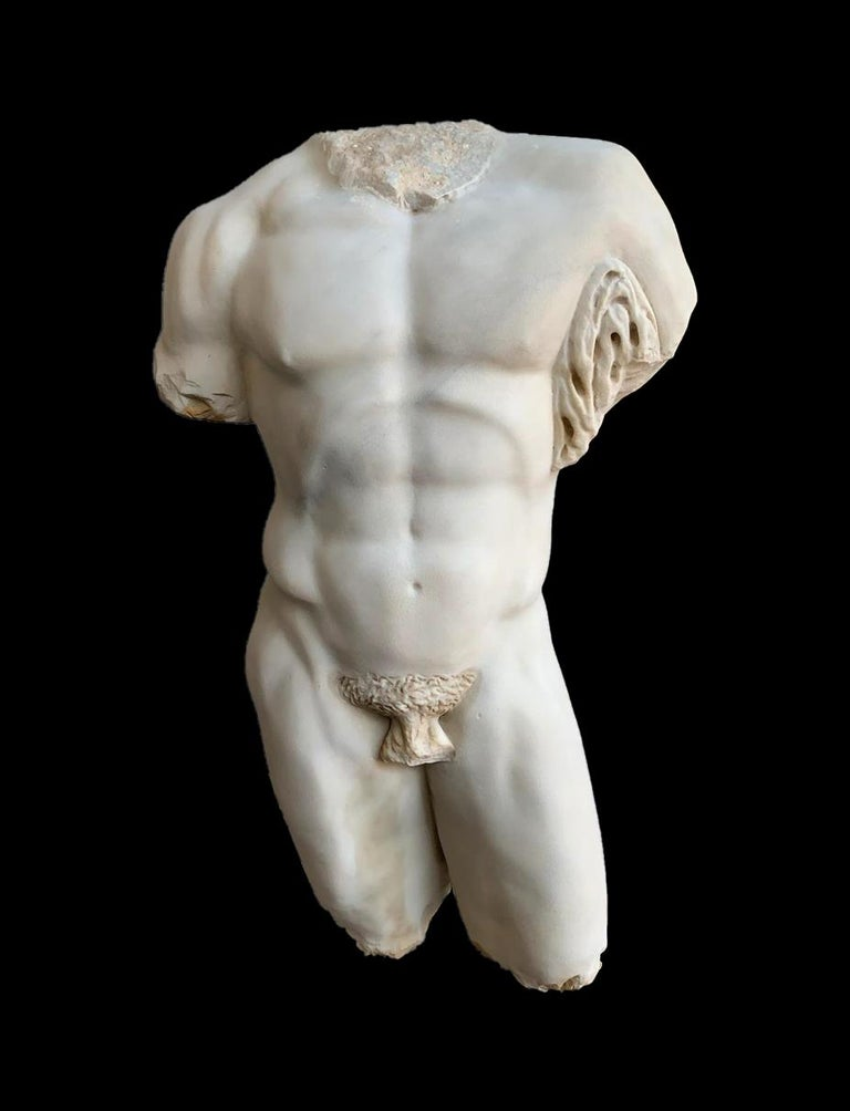 An huge sculpture lifesize torso of the Hercules Farnese in white statuary marble. The Farnese Hercules (Italian: Ercole Farnese) is an ancient statue of Hercules, probably an enlarged copy made in the early third century AD and signed by Glykon,