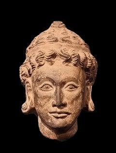 4th Century Gandhara head of a merchant on black stone