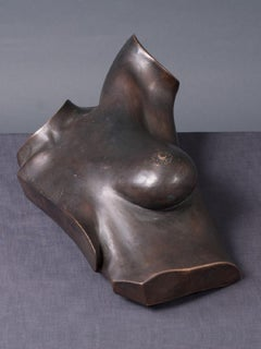 A bronze sculpture of a female torso