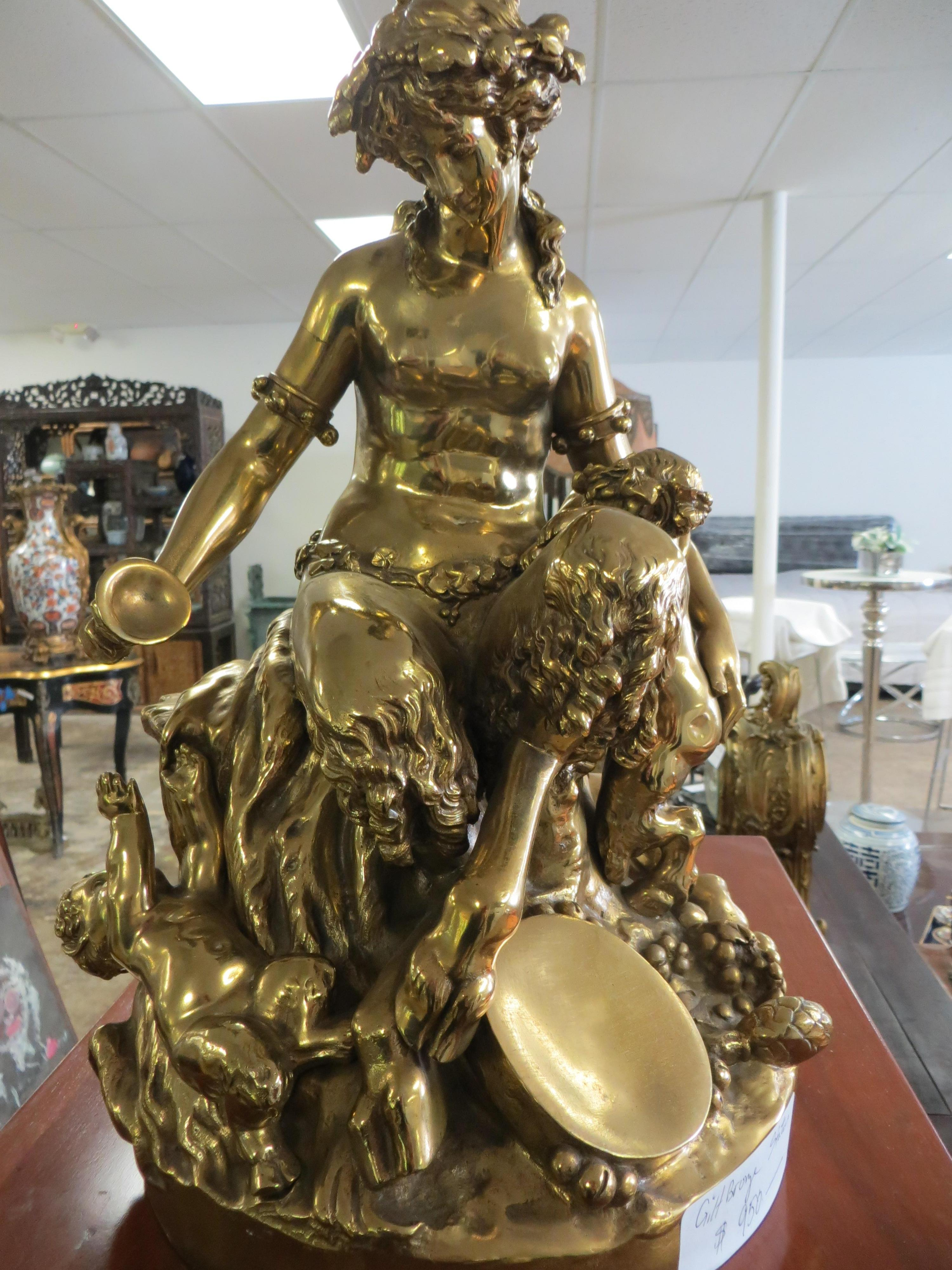 A GOLD PATINATED BRONZE SITTING FAUN