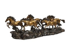 A Massive Patinated Bronze Sculpture of Running Horses