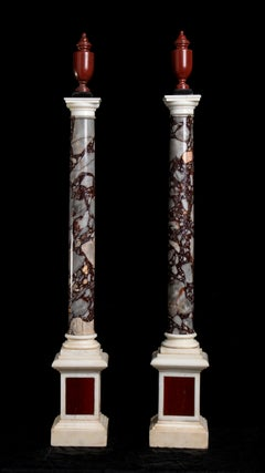A Pair Of Italian Breccia White and Marble Columns Each Surmounted by an Amphora